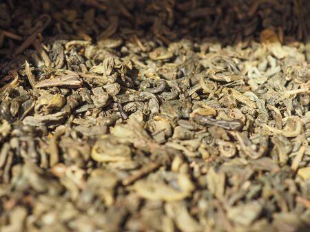gunpowder: green gunpowder tea leaves for brewing tea in hot water Stock Photo