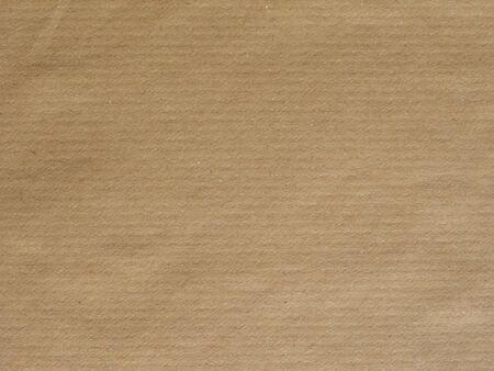 rimmed: light brown paper surface useful as a background Stock Photo