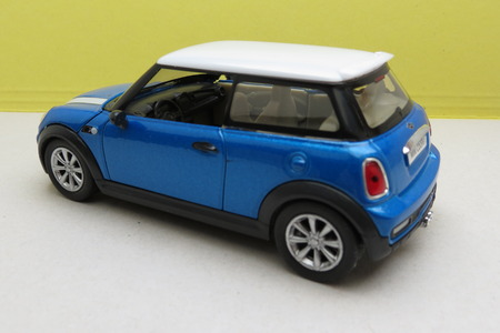 medios de transporte: OXFORD, UK - CIRCA OCTOBER 2015: miniature representation of a light blue Mini Cooper car (2013 version) with white roof produced as a childrens toy in China, circa 2014