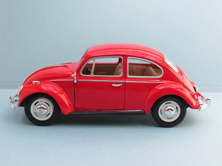 affordable: WOLFSBURG, GERMANY - CIRCA APRIL 2015: Miniature Representation of Volkswagen Type-1 aka Classical Beetle from 1967, produced as a childrens toy in China, circa 2008 Editorial
