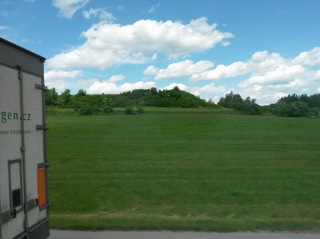 PRAGUE, CZECH REPUBLIC - CIRCA JUNE 2015: green panorama background with grass and trees under a blue sky as seen from a motor road Redakční