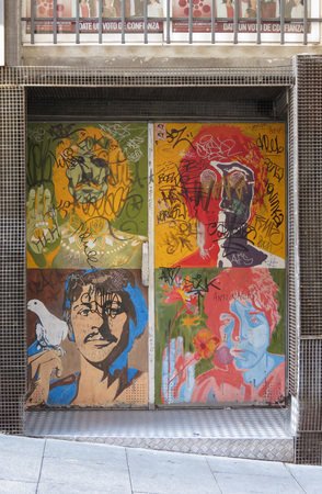 SALAMANCA, SPAIN - CIRCA JUNE 2015: The Beatles pop art portraits by Richard Avedon (1967), reproduced on a night club door, with graffiti