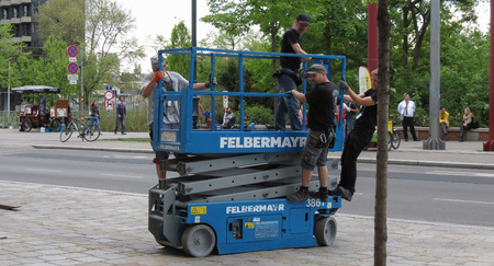 VIENNA, AUSTRIA - CIRCA APRIL 2016: Felbermayr scissor platform with operators