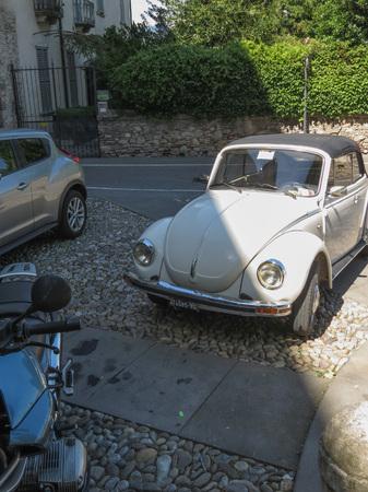 BERGAMO, ITALY - CIRCA JULY 2017: off white Volkswagen Beetle cabrio car