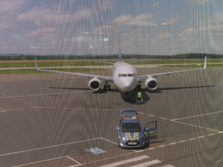ceska: OSTRAVA, CZECH REPUBLIC - CIRCA JULY 2017: RyanAir Boeing 737-800 just landed, with safety car Editorial
