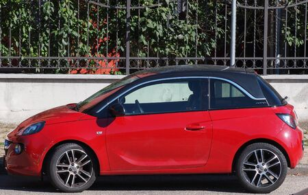 MILAN, ITALY - CIRCA JULY 2017: Red Opel Adam car