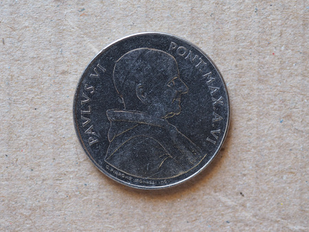 50 liras coin from Vatican released in 1968 (anno VI) bearing the portrait of pope Paul VI