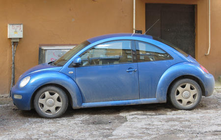 KAUNAS, LITHUANIA - CIRCA APRIL 2017: blue Volkswagen New Beetle car parked in a street of the city centre Editorial