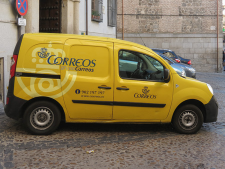 TOLEDO, SPAIN - CIRCA OCTOBER 2017: Correos (i.e. Spanish Mail) van parked in a street of the city centre