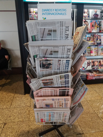 MADRID, SPAIN - CIRCA OCTOBER 2017: Spanish newspapers on display in a newspaper shop at the airport - referendum in Catalogne