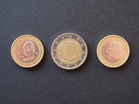 Euro coins money (EUR) from Spain bearing the portrait of former king Juan Carlos I and king Felipe VI (separately on 1 EUR coins and together on 2 EUR coin) Archivio Fotografico