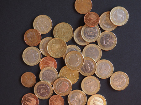Euro coins money (EUR) from Spain bearing the portrait of former king Juan Carlos I and king Felipe VI Archivio Fotografico