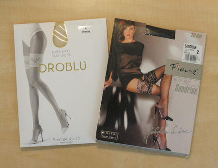 PRAGUE, CZECH REPUBLIC - CIRCA DECEMBER 2017: Italian Oroblu and Polish Fiore hold-ups hosiery on display for sale Editorial