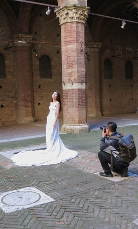 SIENA, ITALY - CIRCA APRIL 2016: Asian bride posing for her photobook in an historical location Editorial