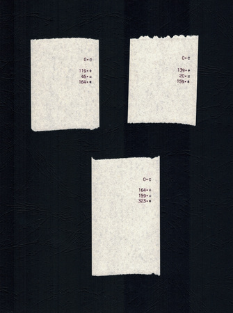 Three bills or receipts isolated over black background Banco de Imagens