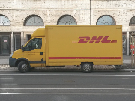LEIPZIG, GERMANY - CIRCA MARCH 2016: DHL post van parked on the street Editorial