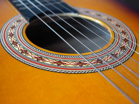 Detail of a folk acoustic guitar with iron strings 版權商用圖片