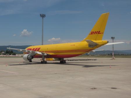 BRATISLAVA, SLOVAKIA - CIRCA JULY 2018: DHL parked at the airport