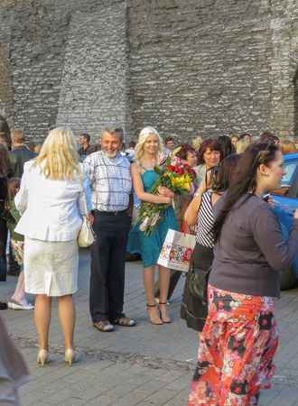 TALLINN, ESTONIA - CIRCA JUNE 2012: elegantly dressed people at a graduation ceremony
