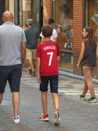 TOULOUSE, FRANCE - CIRCA AUGUST 2018: unidentified boy wearing portuguese footbal champion Cristiano Ronaldo 7 t-shirt Editorial
