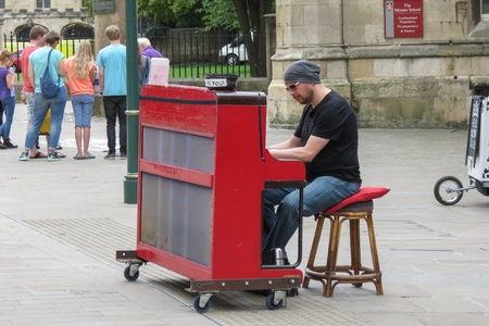 YORK, UK - CIRCA AUGUST 2015: Karl Mullen street piano player performing as usual on the street of York