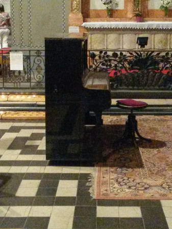 upright piano keyboard music instrument in a church