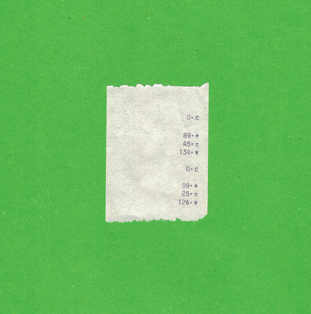 Bill or receipt isolated over green background