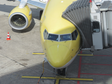 DUESSELDORF (GERMANY), CIRCA OCTOBER 2013: airplane of the DHL mail company parked at the airport ready for boarding, in Duesseldorf, October 2013