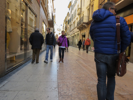 VERONA, ITALY - CIRCA MARCH 2013: people strolling in the very city centre Editöryel
