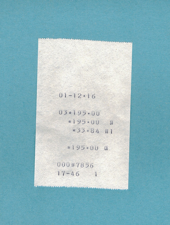 Bill or receipt over light blue background