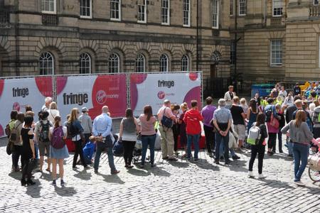EDINBURGH, SCOTLAND, UK - CIRCA AUGUST 2015: a crowd of people at the Fringe street festival