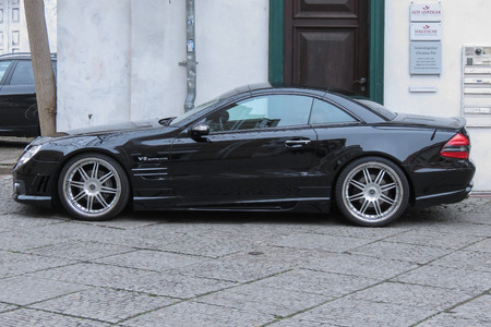HALLE (SAALE), GERMANY - CIRCA MARCH 2016: black Mercedes-Benz SL 55 car parked in a street of the city centre