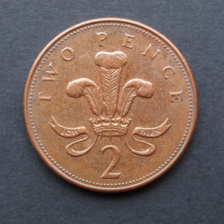 Currency of the United Kingdom 2p coin over black background