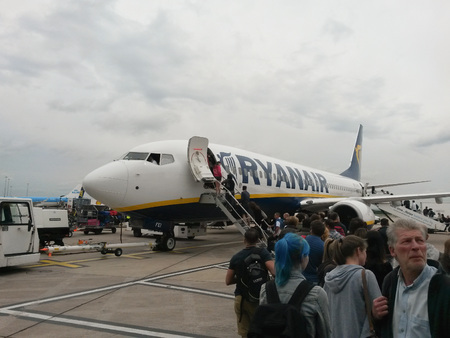 MANCHESTER, UK - CIRCA AUGUST 2015: Boeing 737-800 aircraft of the Ryanair parked at the airport with passengers boarding
