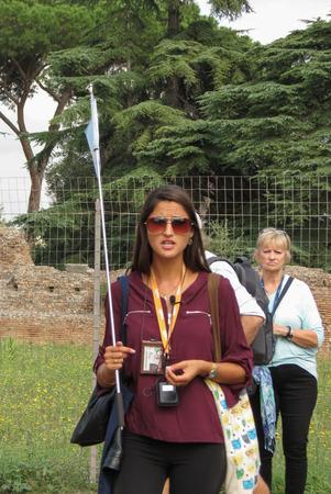 ROME, ITALY - CIRCA OCTOBER 2018: stylish guide at the Roman Forum aka Foro Romano Editöryel
