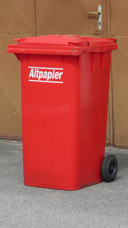 WIEN, AUSTRIA - CIRCA APRIL 2016: Altpapier (meaning Old paper or waste paper) red waste containers aka Litter bin garbage bin trash bin or waste bin