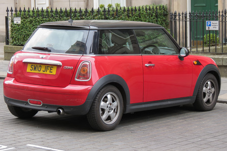 EDINBURGH, SCOTLAND, UK - CIRCA AUGUST 2015: red Mini Cooper car (2013 version)