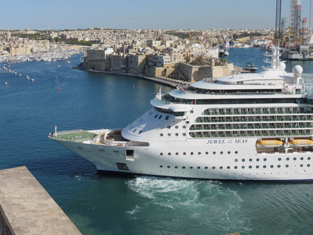 VALLETTA, MALTA - CIRCA MAY 2019: Royal Caribbean's Jewel of the Seas cruise ship leaving Valletta's harbour Editorial