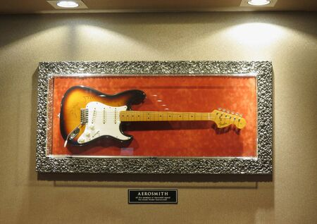 VALLETTA, MALTA - CIRCA MAY 2019: Fender Stratocaster electric guitar signed by all five members of Aerosmith
