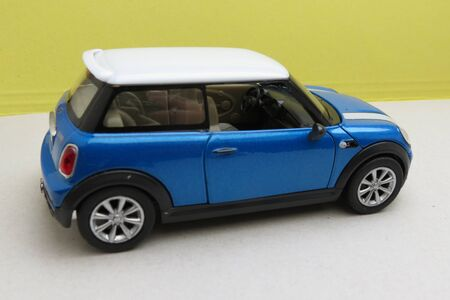 OXFORD, UK - CIRCA OCTOBER 2015: miniature representation of a light blue Mini Cooper car (2013 version) with white roof produced as a children's toy in China, circa 2014