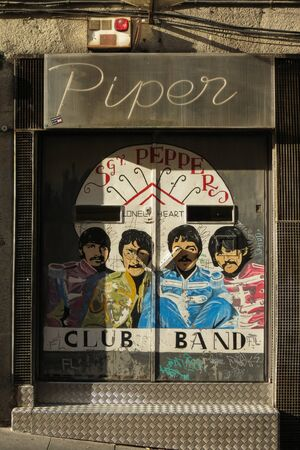 SALAMANCA, SPAIN - CIRCA JUNE 2015: The Beatles dressed in Sgt Pepper's uniforms, reproduced on a night club door, with graffiti