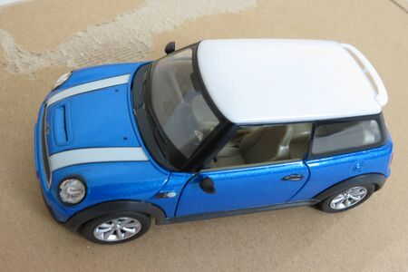 OXFORD, UK - CIRCA OCTOBER 2015: miniature representation of a light blue Mini Cooper car (2013 version) with white roof produced as a childrens toy in China, circa 2014