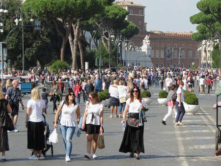 ROME, ITALY - CIRCA OCTOBER 2018: Via dei Fori Imperiali street (formerly Via dellImpero) with tourists stolling