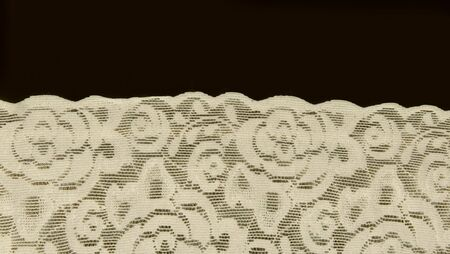 off white floral lace band texture useful as a background