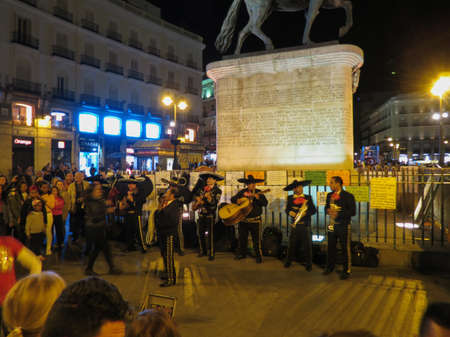 MADRID, SPAIN - CIRCA JANUARY 2018: a band of Mexican mariachi playing outdoors on main square Editorial