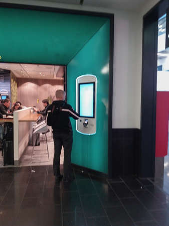 VIENNA SCHWECHAT, AUSTRIA - CIRCA APRIL 2019: mobile like touchscreen for ordering food at McCafe 免版税图像 - 150200799