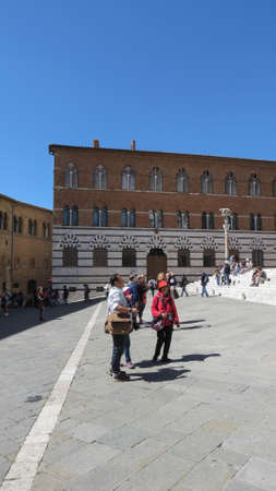 SIENA, ITALY - CIRCA APRIL 2016: tourists in front of the Cathedral church aka Duomo di Siena