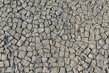 A cobblestone pavement useful as a background Standard-Bild