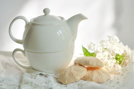 white china teapot and sweet flowers Stock Photo