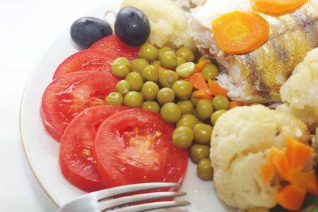baked fish with mixed greens garnish photo